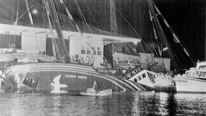 FILE - In this July 10, 1985 file photo, the Greenpeace ship Rainbow Warrior is seen after it was sank in Auckland harbor, after explosions on board.  A retired French secret service agent who says he planted the bombs 30 years ago which sank a Greenpeace ship and killed a photographer has apologized.  Jean-Luc Kister told Television New Zealand Sunday, Sept. 6, 2015, that he and his colleagues never meant to kill anybody when they attached two bombs to the Rainbow Warrior on July 10, 1985, while the boat was moored in Auckland. (NZ Herald via AP, File) NEW ZEALAND OUT