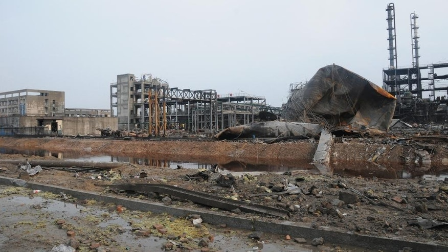 FILE - This Sept. 2, 2015 file photo released by China's Xinhua News Agency shows the accident site after an explosion at Shandong Binyuan Chemical Co., Ltd. in Lijin county, east China's Shandong province. The factory that produces adhesive materials exploded on Aug. 31. (Lou Chen/Xinhua via AP, File) NO SALES