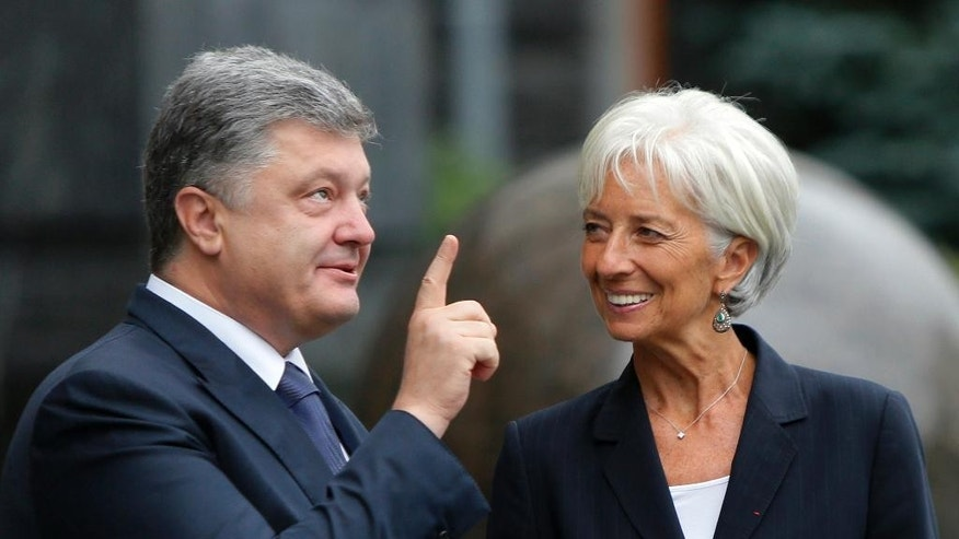 Ukrainian President Petro Poroshenko, left, talks with Managing Director of the International Monetary Fund Christine Lagarde  during of their meeting in Kiev, Ukraine, Sunday, Sept. 6, 2015. (AP Photo/Sergei Chuzavkov)
