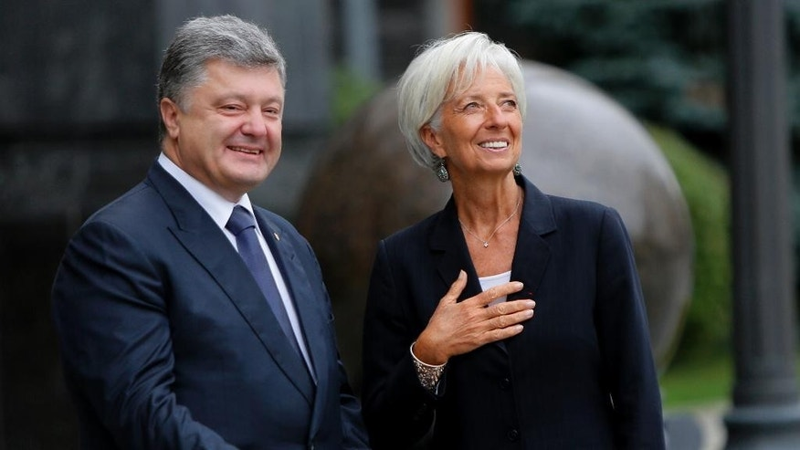 Ukrainian President Petro Poroshenko, left, talk with Managing Director of the International Monetary Fund Christine Lagarde  during of their meeting in Kiev, Ukraine, Sunday, Sept. 6, 2015. (AP Photo/Sergei Chuzavkov)
