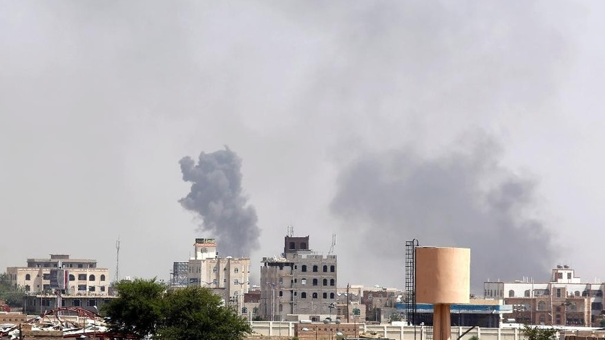 Smoke rises after an airstrike by the Saudi-led coalition in Sanaa, Yemen, Sunday, Sept. 6, 2015. The Saudi-led and U.S.-backed coalition, made up mainly of Gulf nations, has been launching airstrikes against Shiite rebels known as Houthis and their allies since March, part of an increasingly assertive military policy by both the Saudis and the UAE in the region. The rebels and army units loyal to former President Ali Abdullah Saleh are fighting forces loyal to President Abed Rabbo Mansour Hadi, who is in self-imposed exile in Saudi Arabia, as well as southern separatists and local militias. (AP Photo/Hani Mohammed)