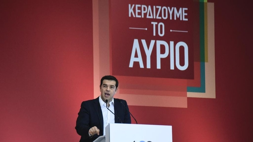 "Alexis Tsipras, leader of left-wing Syriza party and former prime minister, delivers a pre-election speech at the 80th Thessaloniki International Trade Fair (TIF) in the northern Greek port city of Thessaloniki, Sunday, Sept. 6, 2015. Greece heads to general parliamentary elections on Sept. 20, highlighting Greece's need to keep its European course. The slogan reads :""We win the future"". (AP Photo/Giannis Papanikos)"