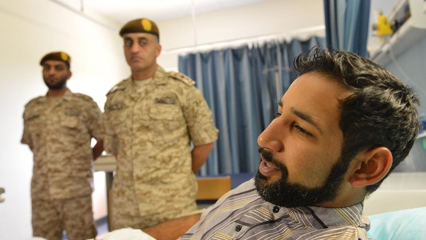 In this Monday, Sept. 7, 2015 photo taken during a media tour, wounded Emirati soldier Bader Abed al-Karim talks to a journalist at the Zayed Military Hospital in Abu Dhabi, United Arab Emirates. The missile attack deaths last week of dozens of Gulf Arab troops in Yemen, most of them from the UAE, has upended much of the ambiguity about the Saudi-led coalition's boots-on-the-ground role and is prompting the alliance to intensify what has become a proxy war against Iran. (AP Photo)