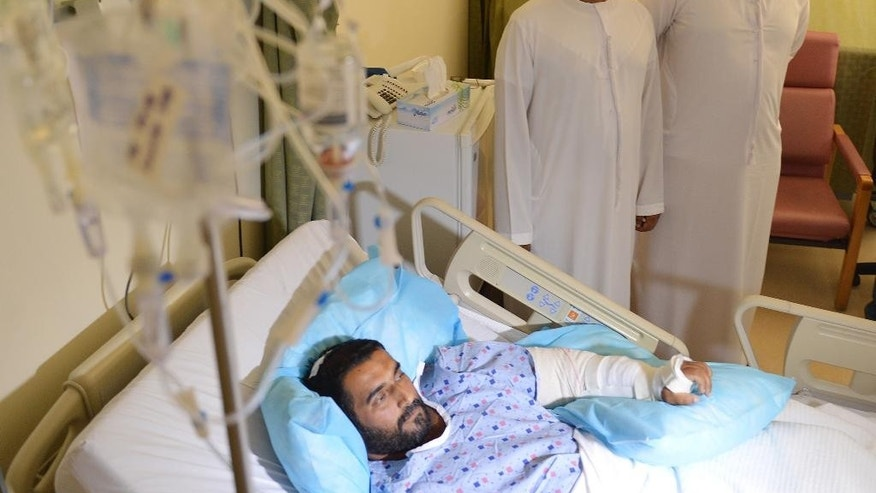 In this Monday, Sept. 7, 2015 photo taken during a media tour, wounded Emirati soldier Mohammed Ali rests in his bed at the Zayed Military Hospital in Abu Dhabi, United Arab Emirates. The missile attack deaths last week of dozens of Gulf Arab troops in Yemen, most of them from the UAE, has upended much of the ambiguity about the Saudi-led coalition's boots-on-the-ground role and is prompting the alliance to intensify what has become a proxy war against Iran. (AP Photo)