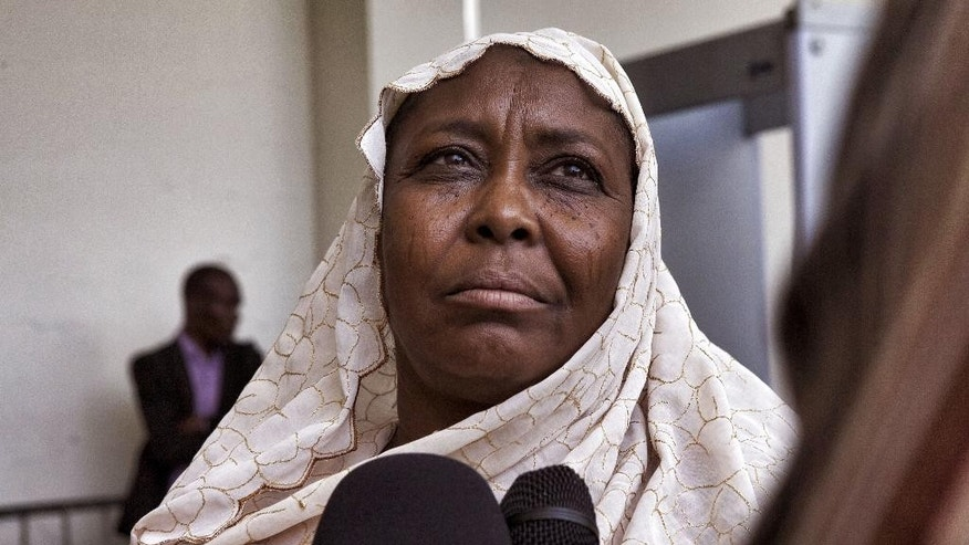 Fatime Sakine, a victim of former Chadian dictator Hissene Habre, speaks to the media during his trail in Dakar, Senegal, Monday, Sept. 7, 2015. Security officers dragged former Chadian dictator Hissene Habre into the courtroom Monday after he refused to take part in his trial on war crimes charges, and some of his supporters had to be removed after they charged to the front of the court. (AP Photo/Jane Hahn)