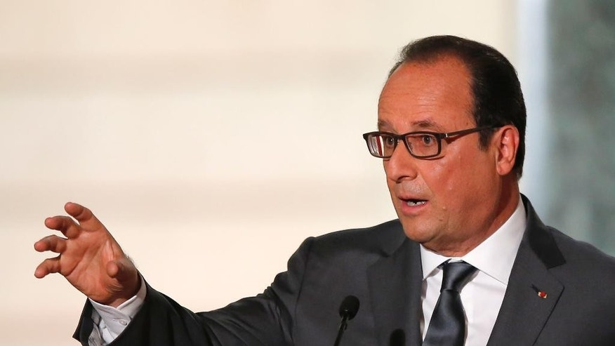 French President Francois Hollande gestures during his press conference at the Elysee Palace in Paris, France, Monday Sept.7, 2015. France will send reconnaissance flights over Syria beginning Tuesday to help plan airstrikes in the fight against the Islamic State group, the president said. (AP Photo/Francois Mori)