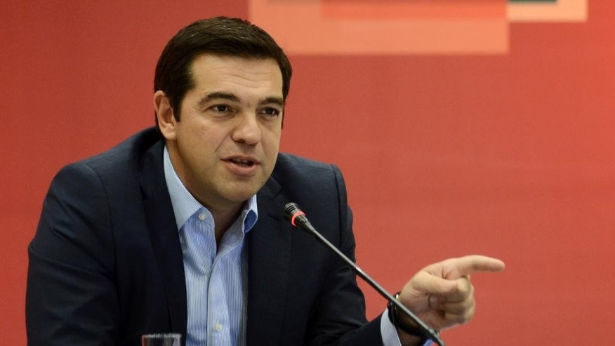 """The leader of the left-wing Syriza party and former Greek Prime Minister Alexis Tsipras answers a question during a news conference at the Vellidio Convention Center in the northern Greek city of Thessaloniki, Monday, Sept. 7, 2015. Tsipras said Sunday the upcoming national election, Sept. 20, is a battle between his """"honorable"""" government of the past seven months and """"the dark period of corruption, cronyism and power networks"""" that prevailed in previous decades. (AP Photo/Giannis Papanikos)"""