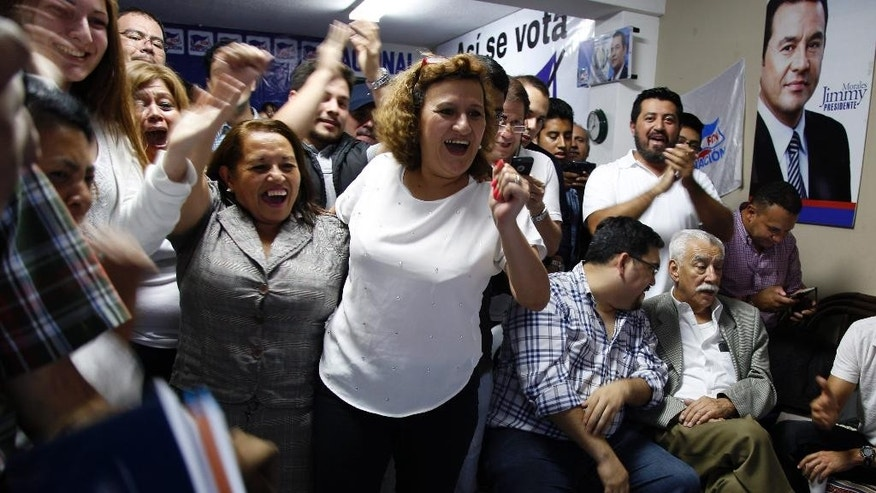 Supporters of television comedian and presidential candidate for the National Front of Convergence party Jimmy Morales, cheer upon listening to the preliminary results of the general elections at their party headquarters in Guatemala City, Sunday, Sept. 6, 2015. The former television comic, a wealthy businessman and a former first lady were ahead in early returns in voting for Guatemala's next leader, days after the Central American nation's president resigned over a corruption scandal. (AP Photo/Luis Soto)