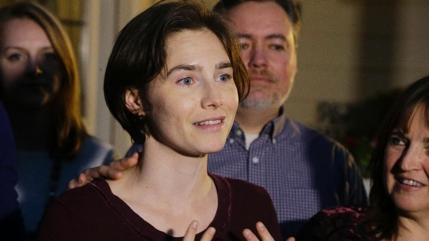 FILE - In this Friday, March 27, 2015 file photo, Amanda Knox talks to members of the media outside her mother's home in Seattle. Italy's top criminal court has scathingly faulted prosecutors for presenting a flawed and hastily constructed case against Amanda Knox and her former Italian boyfriend, saying Monday, Sept. 7, 2015 it threw out their convictions for the 2007 murder of her British roommate in part because there was no proof they were in the bedroom where the woman was fatally stabbed (AP Photo/Ted S. Warren, File)