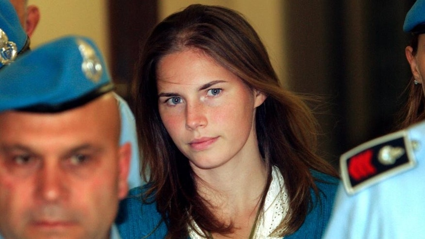 FILE - In this Sept. 26, 2008 file photo, Amanda Knox, center, is escorted by Italian penitentiary police officers to Perugia's court. Italy's top criminal court has scathingly faulted prosecutors for presenting a flawed and hastily constructed case against Amanda Knox and her former Italian boyfriend, saying Monday, Sept. 7, 2015 it threw out their convictions for the 2007 murder of her British roommate in part because there was no proof they were in the bedroom where the woman was fatally stabbed. (AP Photo/Pier Paolo Cito, File)