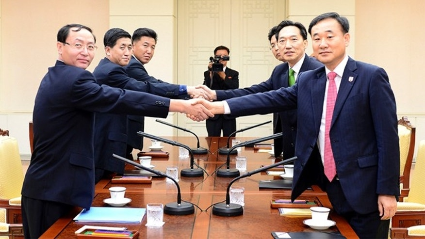 Sept. 7, 2015: In this photo provided by South Korea's Unification Ministry, South Korea's chief delegate Lee Deok-haeng, second from right, shakes hands with North Korean counterpart Pak Yong Il, second from left, before the Inter-Korean Red Cross working level meeting at the border village of the Panmunjom in Paju, South Korea. (The Unification Ministry via AP)