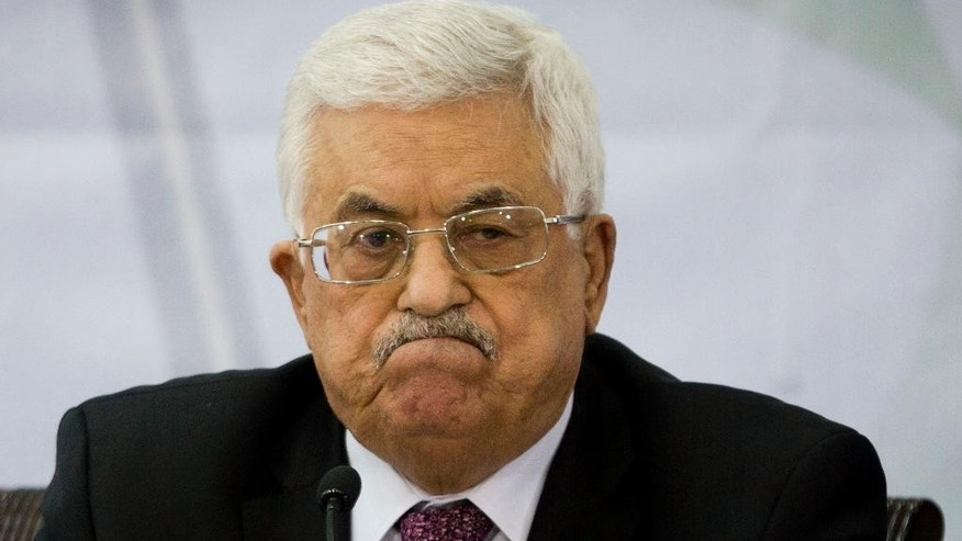 FILE - In this March 4, 2015 file photo, Palestinian President Mahmoud Abbas attends a meeting of the Central Committee of the Palestine Liberation Organization (PLO), in the West Bank city of Ramallah. (AP Photo/Majdi Mohammed, File)