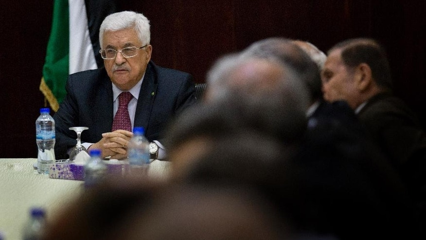 FILE - In this June 22, 2015 file photo, Palestinian President Mahmoud Abbas heads the Palestine Liberation Organization (PLO) Executive Committee meeting at the Palestinian Authority headquarters, in the West Bank city of Ramallah. (AP Photo/Nasser Nasser, File)