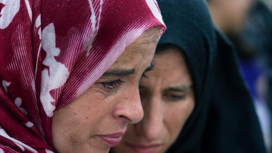 Palestinian women cry during the funeral procession for Riham Dawabsheh, 27, in the West Bank village of Duma, near Nablus, Monday, Sept. 7, 2015. The mother of a Palestinian toddler killed in a West Bank firebomb attack was buried in her village Monday hours after succumbing to wounds sustained in the attack, which also killed the child's father and is believed to have been carried out by Jewish extremists. (AP Photo/Nasser Nasser)