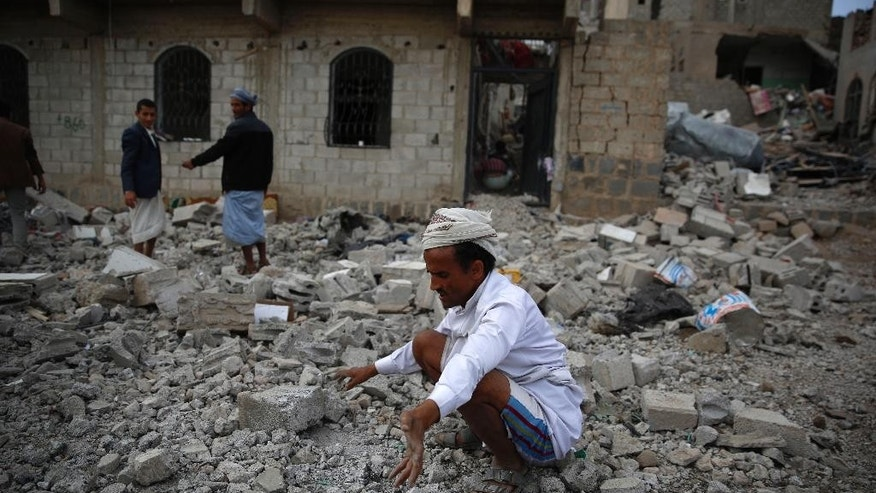 A man inspects on the rubble of a house destroyed by a Saudi-led airstrike in Sanaa, Yemen, Monday, Sept. 7, 2015. (AP Photo/Hani Mohammed)