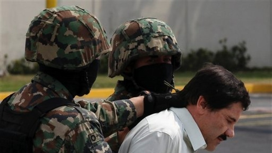 "Feb. 22, 2014: Joaquin ""El Chapo"" Guzman, in handcuffs, is escorted to a helicopter by Mexican navy marines in Mexico City, Mexico."