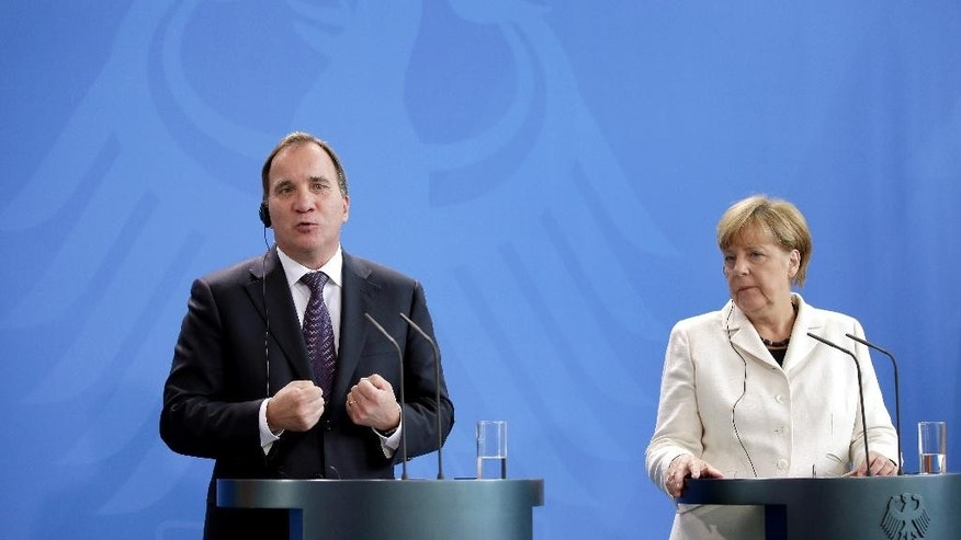 German Chancellor Angela Merkel, right, and the Prime Minister of Sweden, Stefan Lofven, left, address the media during a joint press conference as part of a meeting at the chancellery in Berlin, Germany, Tuesday, Sept. 8, 2015. (AP Photo/Michael Sohn)
