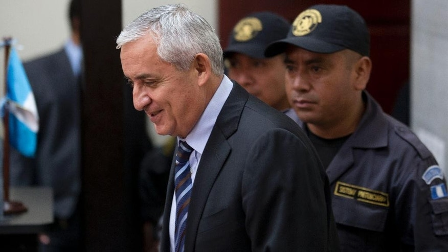 Guatemala's former president Otto Perez Molina arrives in court for a third hearing on corruption allegations that led him to resign, in Guatemala City, Tuesday, Sept. 8, 2015. The court is considering allegations that Perez Molina was involved in a scheme in which businesspeople paid bribes to avoid import duties through Guatemala's customs agency. (AP Photo/Moises Castillo)