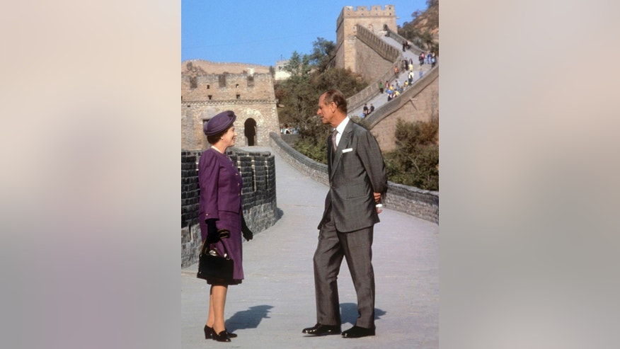 FILE - This is a Oct. 14, 1986  file photo of  Britain's Queen Elizabeth II and Prince Philip at the Bedaling Pass, on the Great Wall of China, on the third day of their State Visit to China.  (Ron Bell/PA File, via AP) UNITED KINGDOM OUT
