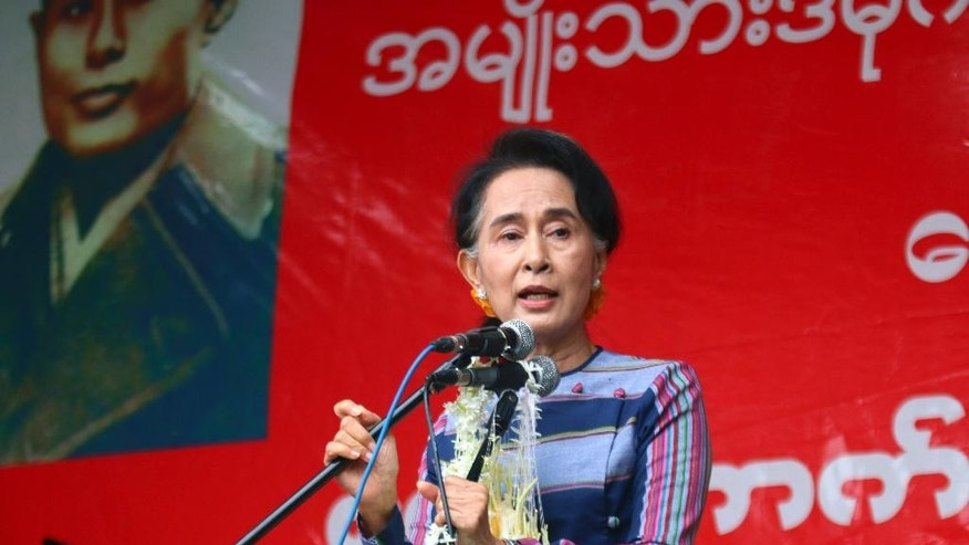 "In this Sept. 6, 2015, file photo, Myanmar opposition leader Aung San Suu Kyi speaks during her ""Election Awareness Tour"" in Ho-Pong township, southern Shan State, Myanmar. The political prisoner-turned-parliamentarian, Suu Kyi, 70-year-old daughter of independence hero Aung San, believes it is her destiny to deliver democracy to Myanmar. But the constitution blocks anyone with a foreign spouse or children from becoming president _ a rule many believe was written with Suu Kyi in mind. (AP Photo/Khin Maung Win, File)"