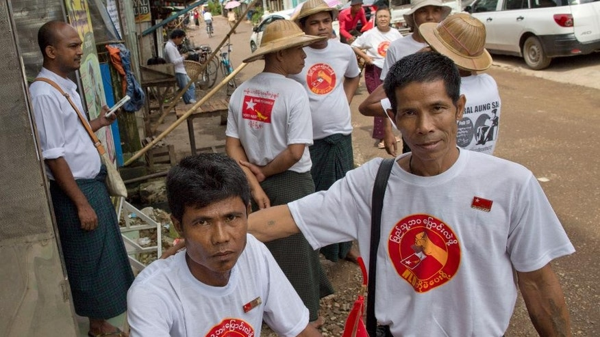 Supporters of Myanmar opposition leader Aung San Suu Kyi's National League of Democracy party gather to start campaigning for upcoming parliamentary elections in Yangon, Myanmar, Tuesday, Sep 8, 2015. On Tuesday, the opposition leader kicked off campaigning for Myanmar's historic Nov. 8 general election with a Facebook post - one of many signs of how far the country and its most recognizable politician have come in a few years. (AP Photo/Gemunu Amarasinghe)
