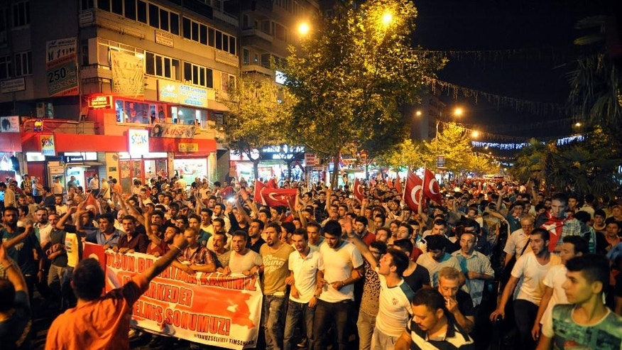 Thousands of people march and shout slogans to denounce terrorism in Bursa, Turkey, late Monday, Sept. 7, 2015,  after Turkey's military announced Monday that 16 soldiers had been  killed and six others were wounded in a Kurdish rebel attack against troops in southeast Turkey on Sunday. The attack was the deadliest assault on Turkish troops since renewed fighting between Kurdish  rebels and Turkey's security forces erupted in July, shattering a fragile peace process.( Depo Photos via AP )