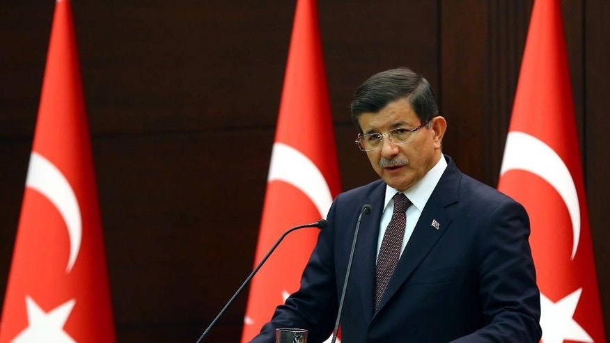 Turkish Prime Minister Ahmet Davutoglu speaks in Ankara, Turkey, Monday, Sept. 7, 2015, a day after Turkey's military announced Monday that 16 soldiers were killed and six others were wounded in a Kurdish rebel attack against troops in southeast Turkey on Sunday. The attack was the deadliest assault on Turkish troops since renewed fighting between the rebels and Turkey's security forces erupted in July, shattering a fragile peace.(AP Photo/Hakan Goktepe, Pool)