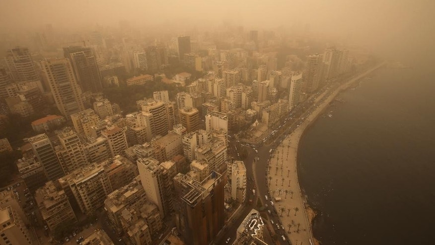 A sandstorm shrouds the capital city of Beirut, Lebanon, Tuesday, Sept. 8, 2015. The unseasonal sandstorm hit Lebanon and Syria, reducing visibility and sending dozens to hospitals with breathing difficulties because of the fine dust. (AP Photo/Hussein Malla)