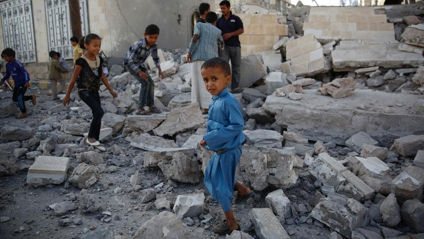 Boys play amid the rubble of a house destroyed by a Saudi-led airstrike in Sanaa, Yemen, Tuesday, Sept. 8, 2015. (AP Photo/Hani Mohammed)