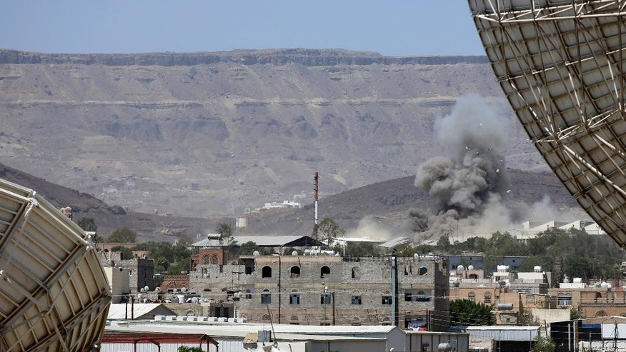 Smoke rises after an airstrike by the Saudi-led coalition on an army base in Sanaa, Yemen, Wednesday, Sept. 9, 2015. The impoverished country is torn between the Yemeni Shiite rebels, known as the Houthis, allied with army units loyal to former President Ali Abdullah Saleh, and forces loyal to exiled President Abed Rabbo Mansour Hadi, who fled to Saudi Arabia in March. (AP Photo/Hani Mohammed)