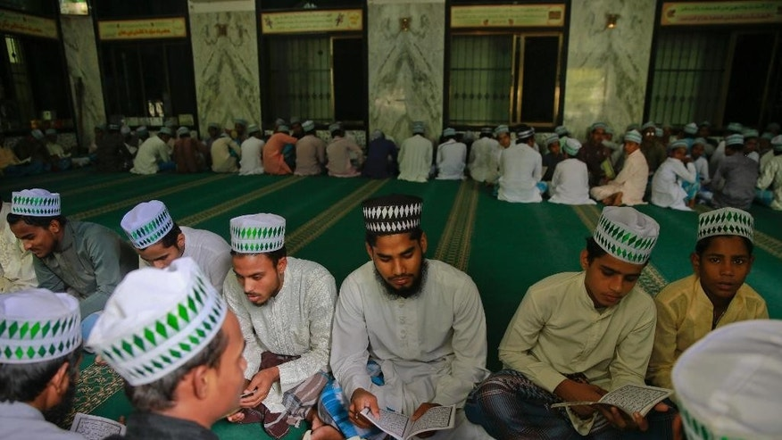 "Indian Muslim students read the holy Quran at the Ajmeri Masjid in Mumbai, India, Wednesday, Sept. 9, 2015. More than 1,000 Muslim clerics in India have ratified a religious ruling that condemns the Islamic State and calls the extremist group's actions ""un-Islamic, a top Indian Muslim leader said Wednesday.(AP Photo/Rafiq Maqbool)"