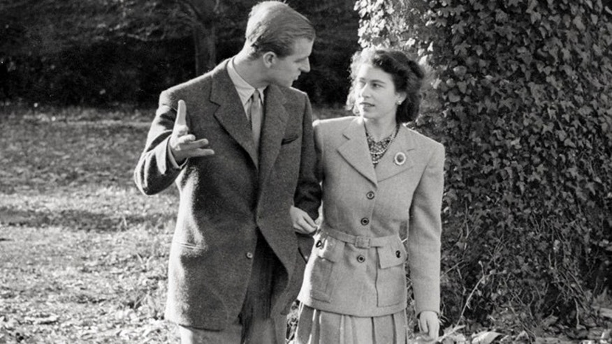 Nov. 1947: Princess Elizabeth and The Duke of Edinburgh walking on the grounds of Broadlands in southern England.