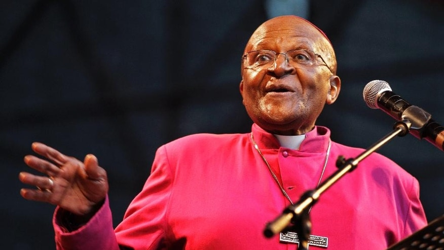 "FILE - In this Sunday, Nov 27, 2011 file photo, South African Archbishop Desmond Tutu speaks during a rally in Durban, South Africa, A South African foundation named after Tutu says refugees fleeing to Europe from conflicts in Syria and elsewhere deserve to be treated as ""equals."" The foundation said Tuesday, Sept. 8, 2015 that people may feel moved by the plight of the refugees, but tend to disavow them when called upon to share with those who look different and have different cultural and religious beliefs. (AP Photo/Schalk van Zuydam,File)"