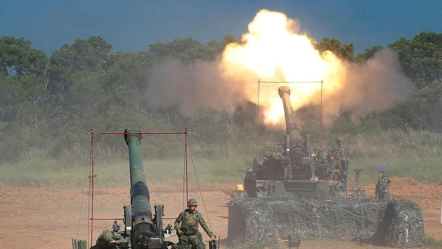 Taiwan's military fire artillery from self-propelled Howitzers during the annual Han Kuang exercises in Hsinchu, north eastern Taiwan, Thursday, Sept. 10, 2015. Taiwan's military is simulating attacks by political rival China this week, despite an overall warming of ties, after Beijing staged what appeared to be a strike against the presidential office in Taipei. (AP Photo/Wally Santana)