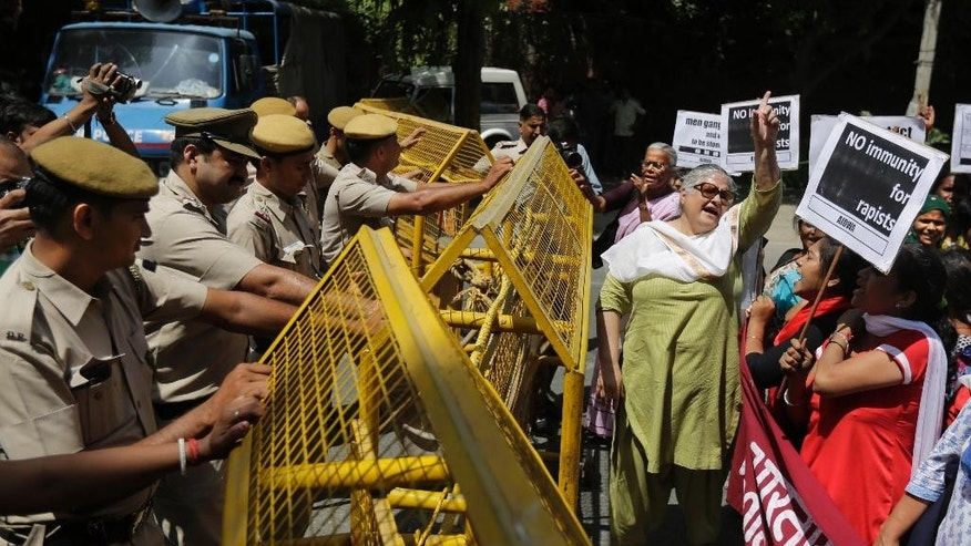 Activists of All India Democratic Women's Association shout slogans during a protest outside the Saudi Arabian embassy in New Delhi, India, Thursday, Sept. 10, 2015. Police in India were investigating complaints from two women that a Saudi Arabian diplomat raped them repeatedly and confined them in his home near New Delhi. He has claimed diplomatic immunity, and the Saudi embassy in a statement Wednesday denied all the allegations. (AP Photo/Altaf Qadri)