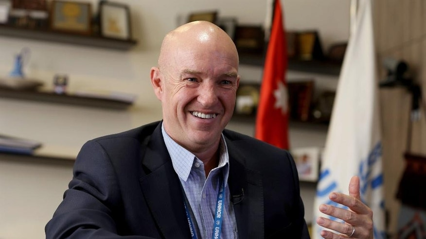 "In this Wednesday, Sept. 9, 2015 . photo, the head of the U.N. refugee agency in Jordan, Andrew Harper, speaks during an interview with The Associated Press in Amman, Jordan. The influx of refugees to Europe was triggered in part by donors taking the ""cheap option"" and not giving enough aid to displaced Syrians in Middle Eastern asylum countries, Harper said in an interview. (AP Photo/Raad Adayleh)"