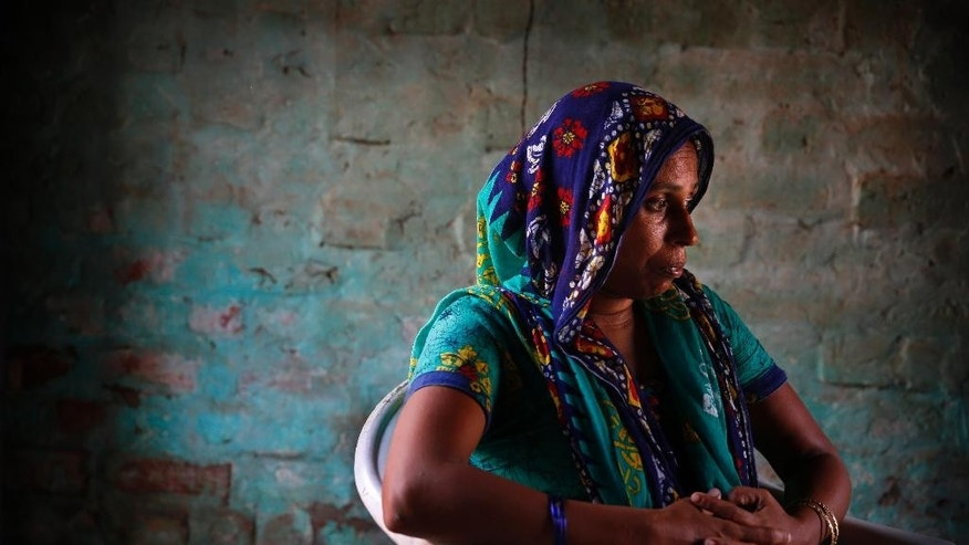 In this Aug. 13, 2015, photo, Anita Berwal, who is from the Indian southern state of Kerala and is married to Sadhuram Berwal from the northern Indian state of Haryana, sits in their home in Sorkhi village, 150 kilometers (93 miles) west of New Delhi.  Berwal's husband traveled  2,700 kilometers (1,700 miles) to meet her since Haryana is known for its shortage of brides --  the direct consequence of the skewed gender ratio in the state, due to sex-selective abortions in a society where many families prize boys over girls, mostly for economic reasons.  But women who move to Haryana to get married _ especially those from the better-off south _ face enormous adjustments, practical and cultural. (AP Photo/Manish Swarup)