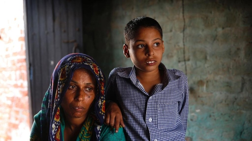 In this Aug. 13, 2015, photo, Anita Berwal, from the Indian southern state of Kerala and is married to Sadhuram Berwal who is from the northern Indian state of Haryana, sits with their daughter at their home in Sorkhi village, 150 kilometers (93 miles) west of New Delhi.  To marry her, Berwal's husband traveled 2,700 kilometers (1,700 miles) from his home state of Haryana known for its shortage of brides --  the direct consequence of the skewed gender ratio in the state, due to sex-selective abortions in a society where many families prize boys over girls, mostly for economic reasons.  (AP Photo/ Manish Swarup)