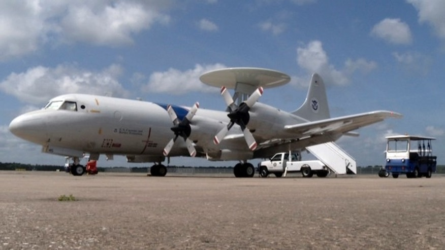 A P-3 surveillance plane is readied for takeoff in July 2015, in Jacksonville, Fla. While the eastern Pacific Ocean remains the most popular route for cocaine smuggling, the Caribbean is again becoming a popular option decades after U.S. authorities all but shut down cocaine smuggling into South Florida in the notorious era of the cocaine cowboys that started in the 1970s.  (AP Photo/Joshua Replogle)