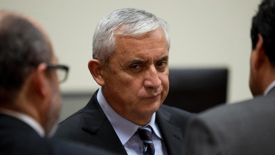 Guatemala's former president Otto Perez Molina listens to his lawyers in court, during his third corruption hearing, in Guatemala City, Tuesday, Sept. 8, 2015. Perez Molina was ordered jailed on charges of fraud, conspiracy and bribery in connection to a customs corruption scandal that took down much of his government and forced him to resign. (AP Photo/Moises Castillo)