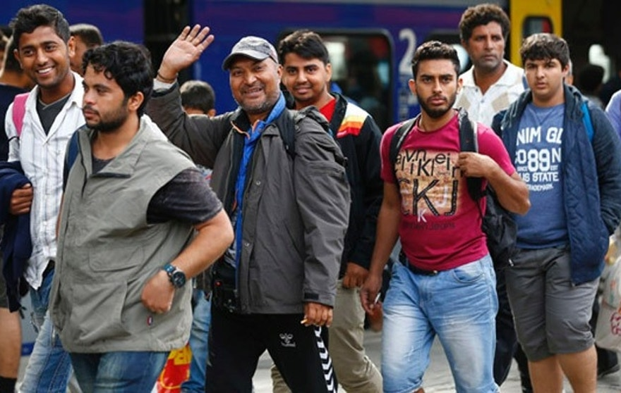 Refugees arrive at the main station in Munich last week after Austria and Germany threw open their borders to thousands bused to the Hungarian border by a right-wing government that had tried to stop them but was overwhelmed by the sheer numbers. (Reuters)