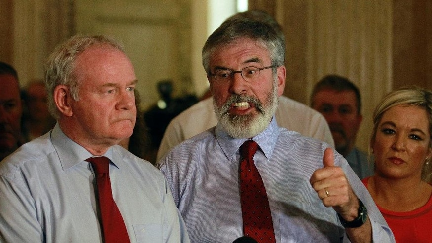 Sinn Fein party leader Gerry Adams, right, and Martin McGuinness speak to the media at Parliament Buildings, Stormont, Belfast, Northern Ireland, Thursday, Sept. 10, 2015.  A political crisis at Stormont has developed over the recent murder of Kevin McGuigan, the status of the IRA, and the viability of the Catholic-Protestant power-sharing government.  (AP Photo/Peter Morrison)