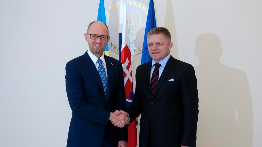 Slovak Prime Minister Robert Fico, right, welcomes Ukrainian Prime Minister Arseniy Yatsenyuk before their meeting in Bratislava, Slovakia, Thursday, Sept. 10, 2015. (/Martin Mikula/CTK photo  via AP)  SLOVAKIA OUT