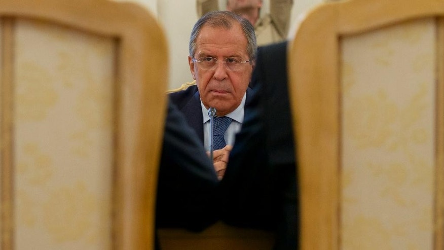 Russian Foreign Minister Sergey Lavrov listens his counterparts Ibrahim Gandour, from Sudan, left, and Benjamin Barnaba, from South Sudan, right, during their trilateral meeting in Moscow, Russia, on Thursday, Sept. 10, 2015. (AP Photo/Ivan Sekretarev)