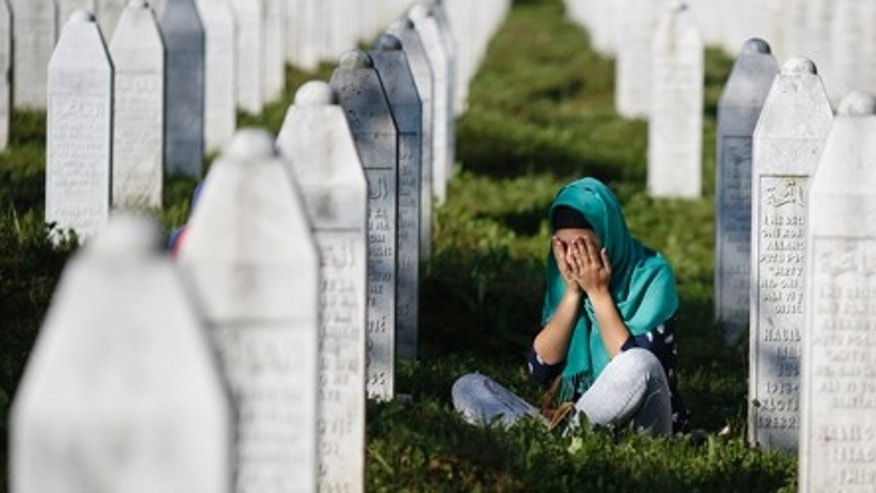 July 11, 2015: A woman mourns among graves in Memorial Center Potocari, near Srebrenica, Bosnia and Herzegovina.