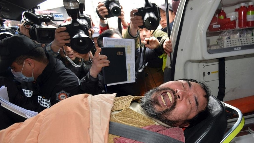 FILE - In this March 5, 2015, file photo, South Korean Kim Ki-jong is carried on a stretcher off an ambulance as he arrives at a hospital in Seoul, South Korea. A Seoul court on Friday, Sept. 11, 2015, handed a 12-year prison sentence to Kim who slashed and seriously injured the U.S. Ambassador Mark Lippert during a March forum. Kim was convicted of attempted murder, assaulting a foreign envoy and obstruction, according to court spokesman Joon Young Maeng. (Han Jong-chan/Yonhap via AP, File) KOREA OUT