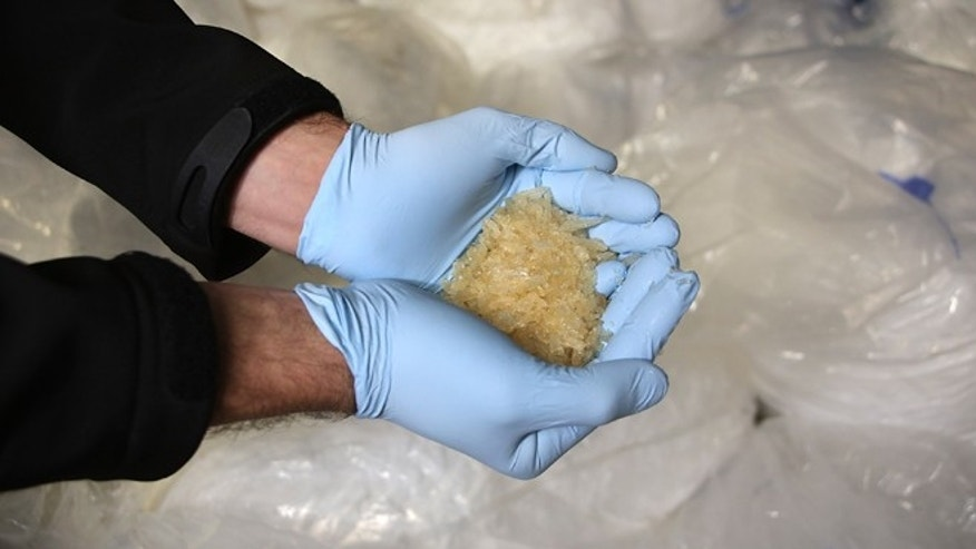 WIESBADEN, GERMANY - NOVEMBER 13:  Members of the Bundeskriminalamt German law enforcement agency (BKA), the Federal Criminal Office, display portions of 2.9 tonnes of recently-confiscated chlorephedrin, one of the main ingredients used to manufacture methamphetamine, also called crystal meth, at a press conference on November 13, 2014 in Wiesbaden, Germany. Police from Saxony, Thuringia and the Czech Republic broke a crystal meth manufacturing ring earlier this month and confiscated the haul, which is enough to produce 2.3 tonnes of crystal meth, and also made at least 16 arrests, including the ring leader, a 32-year-old pharmaceuticals retailer from Leipzig. Crystal meth has evolved into a major scourge in the Czech-German border region and is becoming a popular drug in cities deeper inside Germany.  (Photo by Hannelore Foerster/Getty Images)