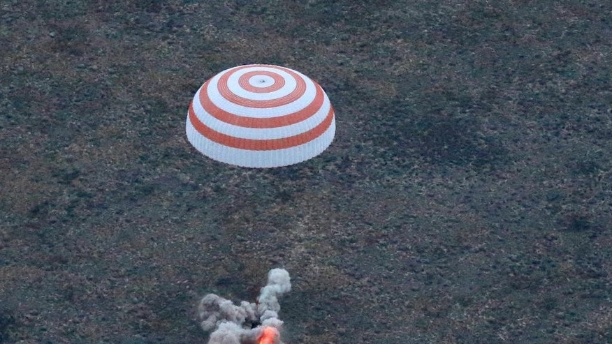 The Russian Soyuz TMA-16M capsule carrying a crew of Russia's Gennady Padalka, Andreas Mogensen of the European Space Agency and Kazakhstan's Aidyn Aimbetov lands some 146 kilometers (90 miles) southeast of town of Dzhezkazgan, Kazakhstan, early Saturday, Sept. 12, 2015. Padalka has completed his fifth mission for the world's record 879 cumulative days in space, more than two months longer than the previous record holder, Russian cosmonaut Sergei Krikalev. (Yuri Kochetkov/Pool Photo via AP)