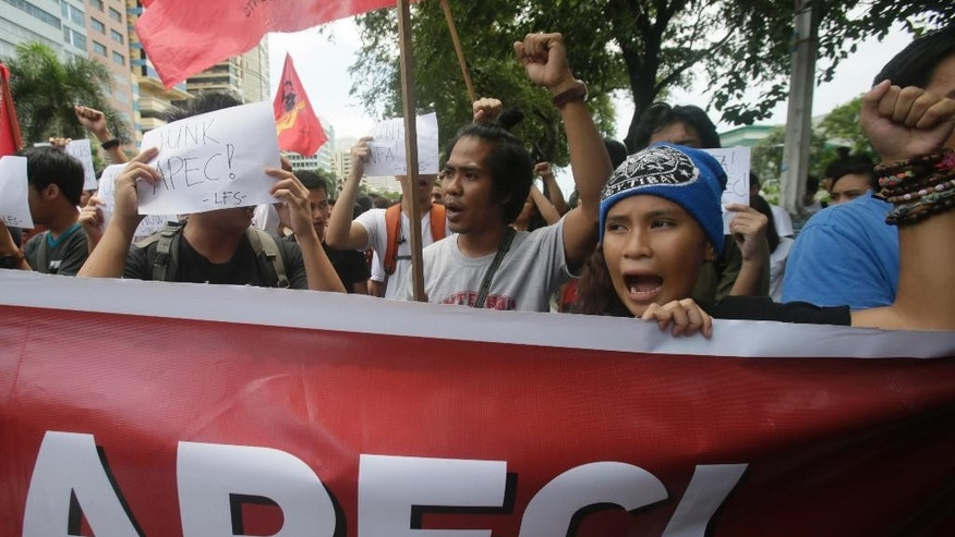 Students shout slogans as they march towards the U.S. Embassy for a rally to protest the ongoing APEC (Asia Pacific Economic Cooperation) Finance Ministers Meeting which culminates in the APEC Economic Leaders Summit in November, Friday, Sept. 11, 2015 in Manila, Philippines. (AP Photo/Bullit Marquez)