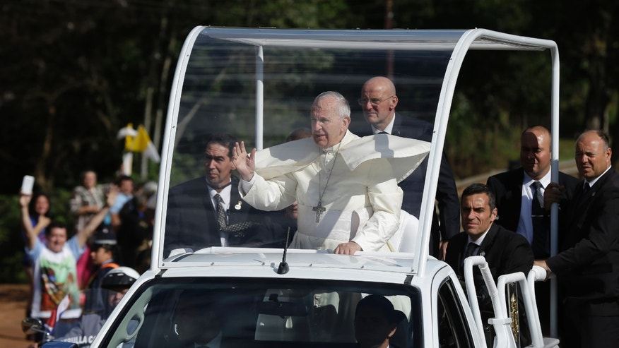 July 11, 2015 - FILE photo of Pope Francis in his popemobile in Caacupe, Paraguay. Cuba's highest authority says it's releasing 3,522 prisoners ahead of the pope's visit to the island next week.